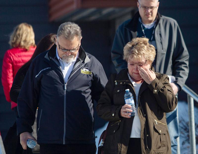 Brad Cross and Marilyn Cross, parents of the Humboldt Broncos assistant coach Mark Cross, walk out of the Kerry Vickar Centre after the sentencing for truck driver Jaskirat Sidhu. (AP)