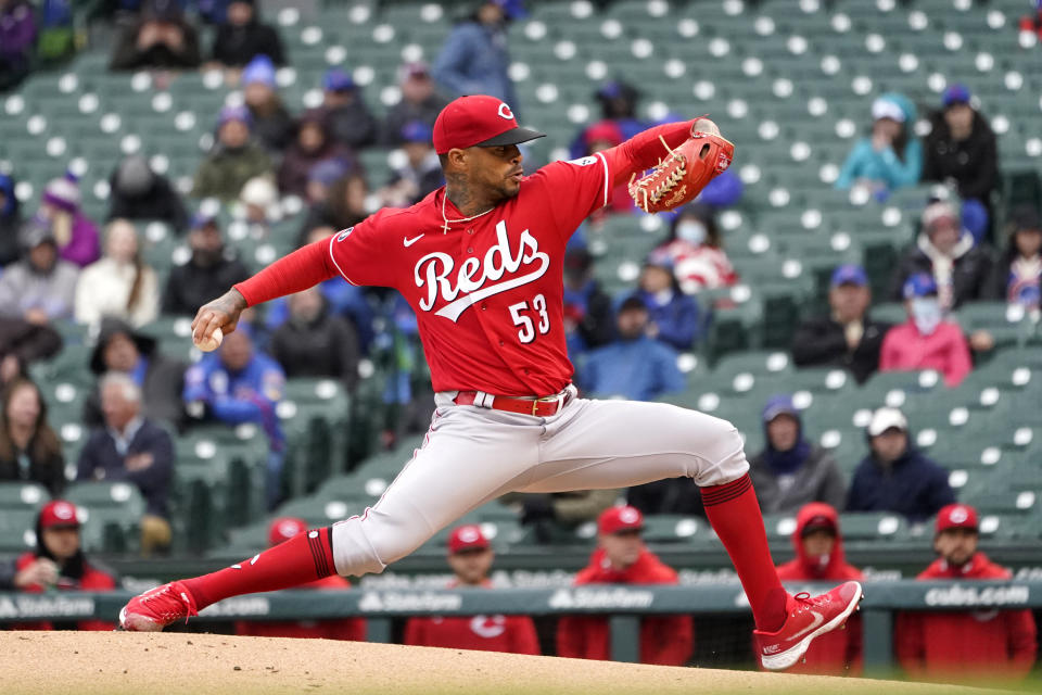 Cincinnati Reds starting pitcher Vladimir Gutierrez delivers during his major league debut in the first inning of a baseball game against the Chicago Cubs, Friday, May 28, 2021, in Chicago. (AP Photo/Charles Rex Arbogast)