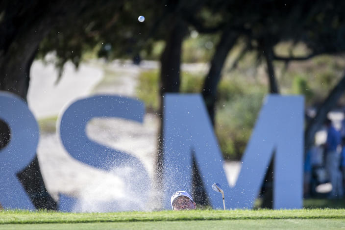 Kevin Kisner hits out the bunker on the 15th green during third round of the RSM Classic golf tournament, Saturday, Nov. 21, 2020, in St. Simons Island, Ga. (AP Photo/Stephen B. Morton)