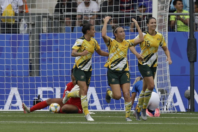 709f93bf34b Australia's Caitlin Foord, center, celebrates with teammates after scoring  her side's first goal during