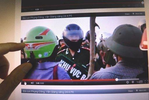 A man watches a video posted on the blog of Dr. Nguyen Xuan Dien showing villagers challenging policemen during forced land evictions in Van Giang district in April 2012. These shaky images spread like wildfire on Facebook, in a sign of growing online defiance in Vietnam
