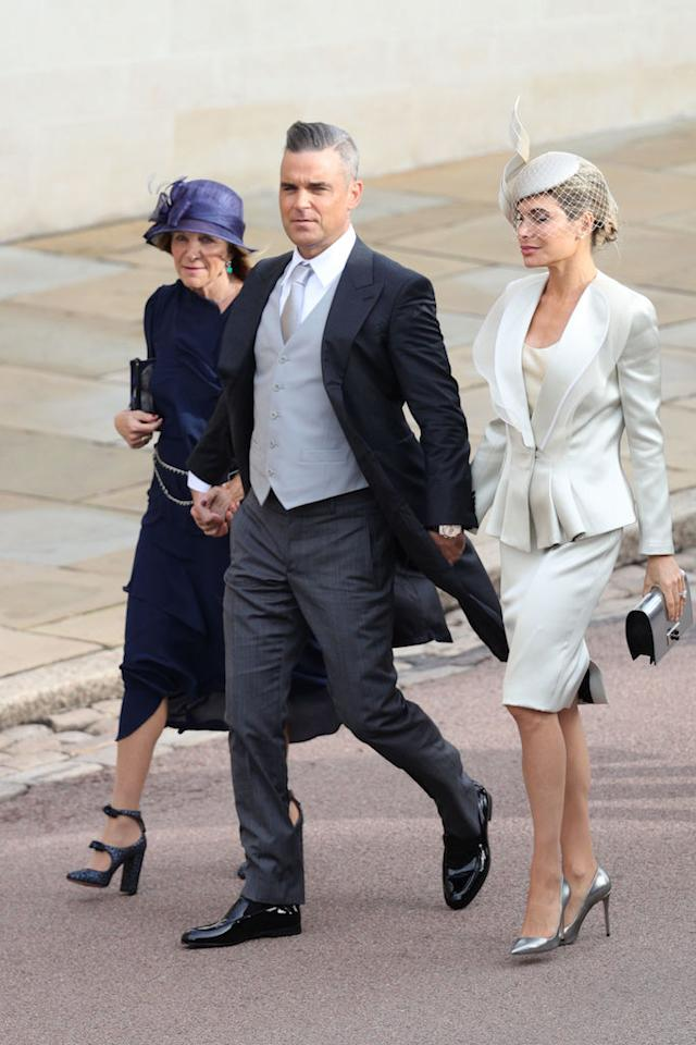 <p>Robbie Williams and Ayda Field were one of the first A-list couples to arrive at St George's Chapel in Windsor. <em>[Photo: PA]</em> </p>