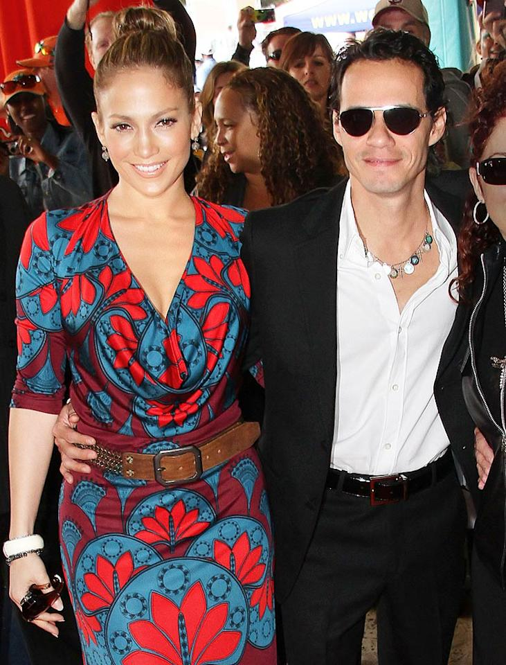 "J.Lo rocks her signature glow and a fun frock while arriving at a Miami Dolphins game with her hubby, sultry singer Marc Anthony. Theirs is the third marriage for Jennifer, who says there's ""a lot of work that goes into making a successful partnership."" Jackson Lee/<a href=""http://www.splashnewsonline.com"" target=""new"">Splash News</a> - January 3, 2010"