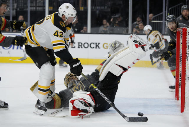 Boston Bruins right wing David Backes (42) attempts a shot on Vegas Golden Knights goaltender Marc-Andre Fleury during the third period of an NHL hockey game Tuesday, Oct. 8, 2019, in Las Vegas. (AP Photo/John Locher)