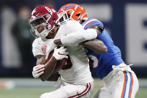 Alabama wide receiver DeVonta Smith (6) runs against Florida during the second half of the Southeastern Conference championship NCAA college football game, Saturday, Dec. 19, 2020, in Atlanta. (AP Photo/Brynn Anderson)