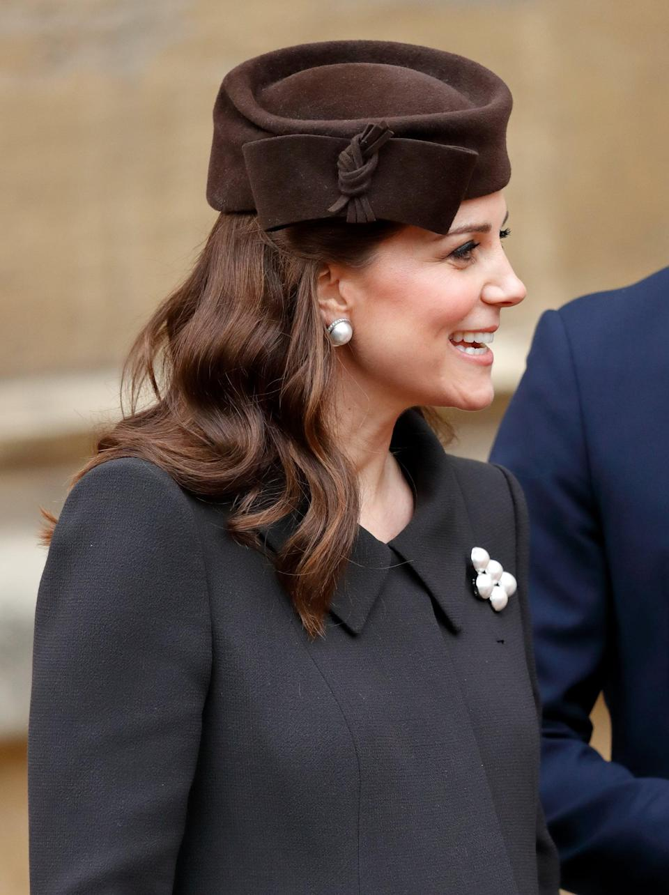 <p>Middleton wore casual waves and a pillbox hat to Easter Sunday Service in Windsor. </p>