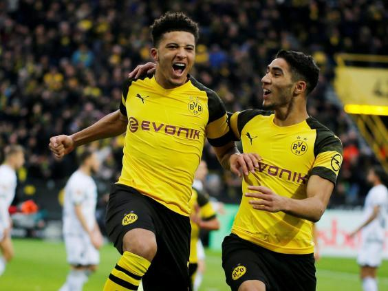 Jadon Sancho has excelled playing under Lucien Favre (REUTERS)