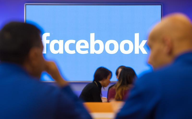 A Facebook logo is displayed on a screen at Facebook's new Frank Gehry-designed headquarters at Rathbone Place in London. (Photo by Dominic Lipinski/PA Images via Getty Images)