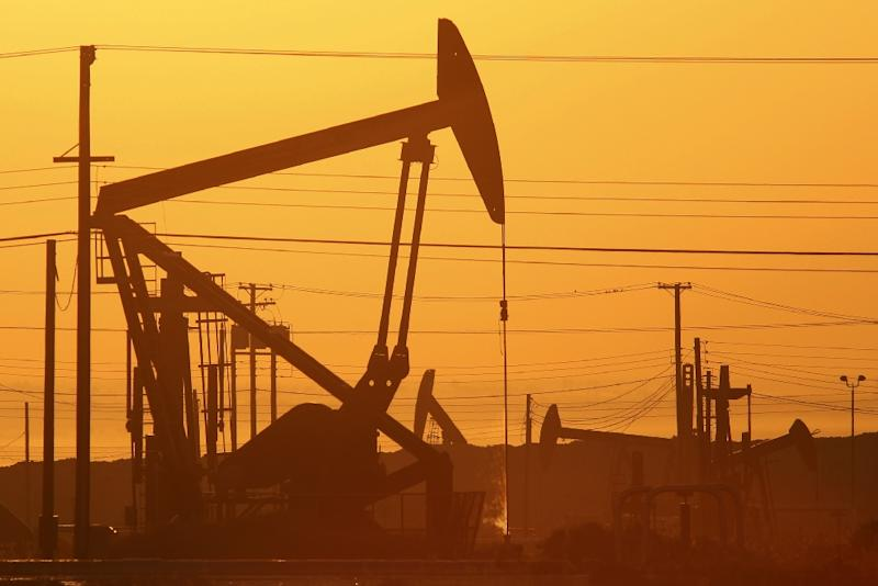 The oversupply of crude oil is expected to last into 2016, with no production cuts in sight (AFP Photo/David Mcnew)