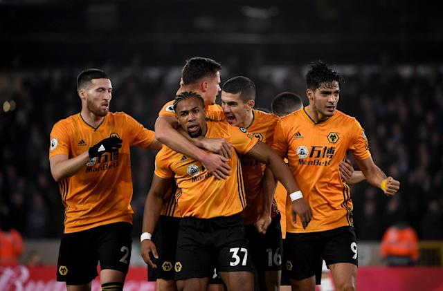 Wolves celebrate with Adama Traore (37), who assisted on Raul Jimenez's equalizer in an eventual 3-2 win over Manchester City. (Sam Bagnall/AMA/Getty Images)