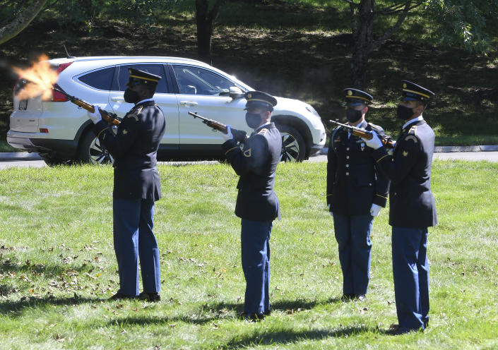 An Army Honor Guard detail fires a salute as Korean War veteran Army Cpl. Walter Smead, a member of Battery A, 57th Field Artillery Battalion, 7th Infantry Division who was killed during the 1950 Battle of the Chosin Reservoir, is laid to rest with full military honors at Gerald B. H. Solomon Saratoga National Cemetery, on Monday, Sept. 20, 2021, in Schuylerville, N.Y. Korean War veteran Army Cpl. Walter Smead, a member of Battery A, 57th Field Artillery Battalion, 7th Infantry Division who was killed during the 1950 Battle of the Chosin Reservoir, is laid to rest with full military honors at Gerald B. H. Solomon Saratoga National Cemetery, on Monday, Sept. 20, 2021, in Schuylerville, N.Y. Smead was finally laid to rest near his rural upstate New York hometown, seven decades after he was killed in the Korean War and months after his remains were finally identified with help from DNA analysis. (AP Photo/Hans Pennink)