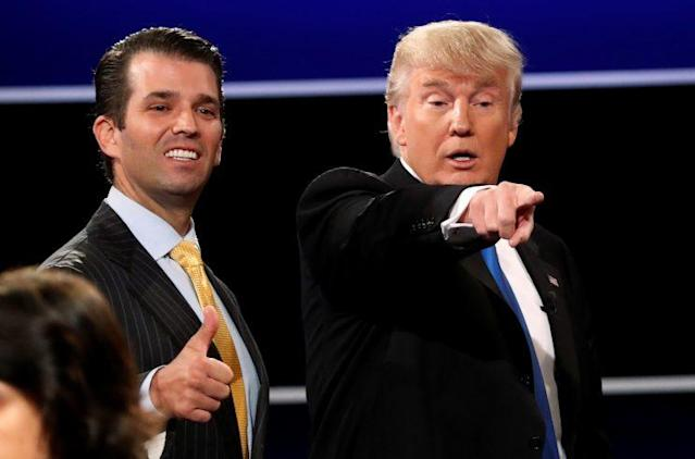 Donald Trump Jr. (L) gives a thumbs up beside his father Donald Trump (R) in Hempstead, New York, U.S. September 26, 2016. REUTERS/Mike Segar