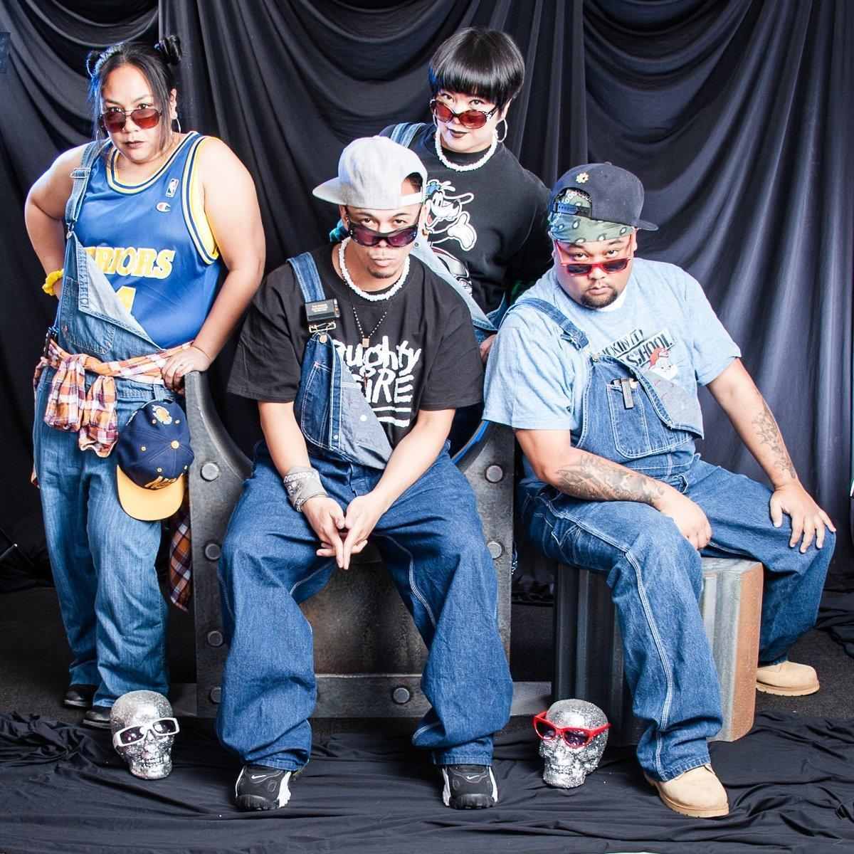 Group of people wearing 1990s hip-hop fashion and overalls