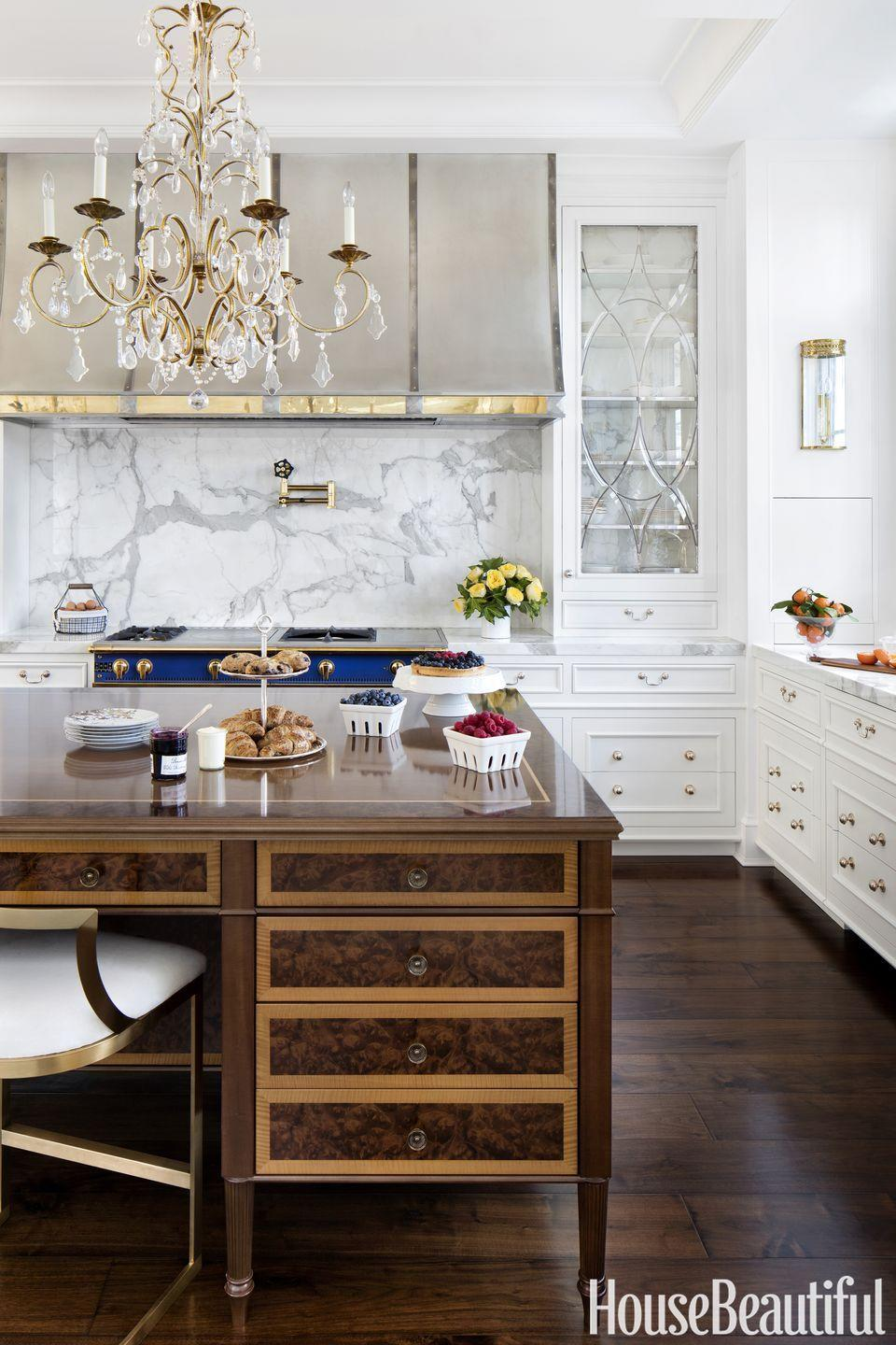 "<p>Crafted from walnut, imbuia, and anigre, the nearly 11-foot-long <span class=""redactor-unlink"">island</span> in this <a href=""https://www.housebeautiful.com/room-decorating/kitchens/g4304/richard-anuszkiewicz-kitchen/"" rel=""nofollow noopener"" target=""_blank"" data-ylk=""slk:kitchen by Richard Anuszkiewicz"" class=""link rapid-noclick-resp"">kitchen by Richard Anuszkiewicz </a>was inspired by English antiques. Elegance to the max. </p>"