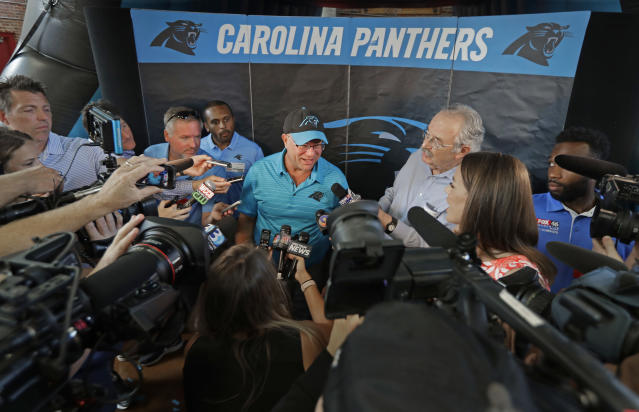 "Carolina Panthers owner David Tepper speaks to the media after a ""kickoff rally"" at Thomasboro Academy in Charlotte, N.C., Tuesday, Aug. 28, 2018. Tepper's charitable foundation along with several players groups and other partners will provide over 12,000 backpacks full of supplies to 17 elementary schools in Charlotte-Mecklenburg Schools, as well as an additional school in Kannapolis City Schools. (AP Photo/Chuck Burton)"