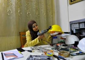 "Woman in Gaza recycles electronic devices to create ""smart hat"""