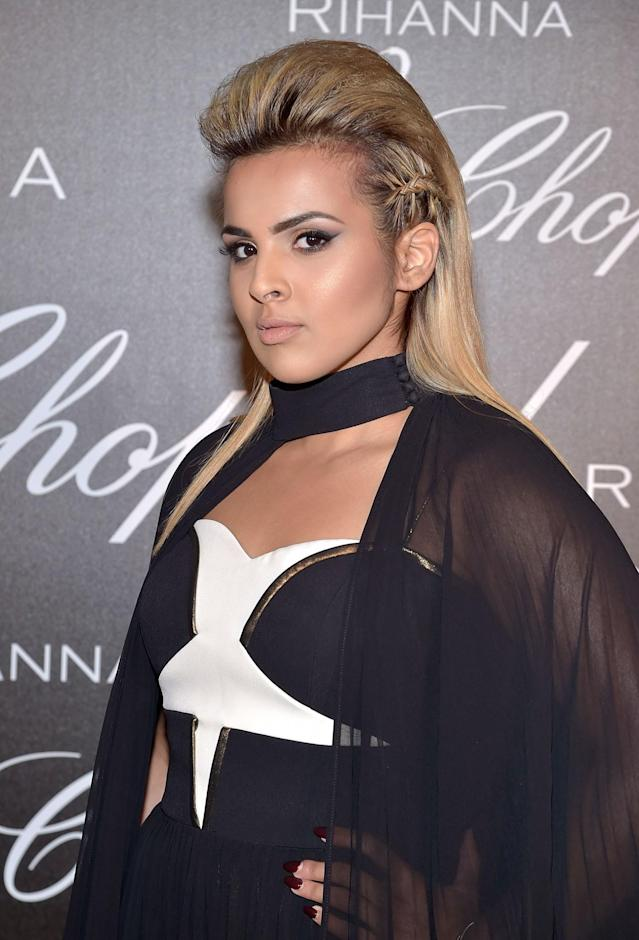 <p>We love Al Thani's modern pompadour hairstyle with side braid accents, as the heightened hairstyle draws our attention to her winged eyeliner and highlighted cheekbones. (Photo: Getty Images) </p>