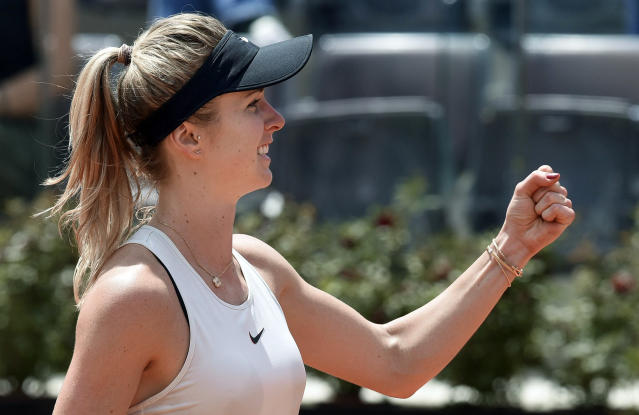 Ukraine's Elina Svitolina celebrates after defeating Estonia's Anett Kontaveit during their women's singles semifinal, at the Italian Open tennis tournament in Rome on Saturday, May 19, 2018. (Claudio Onorati/ANSA via AP)