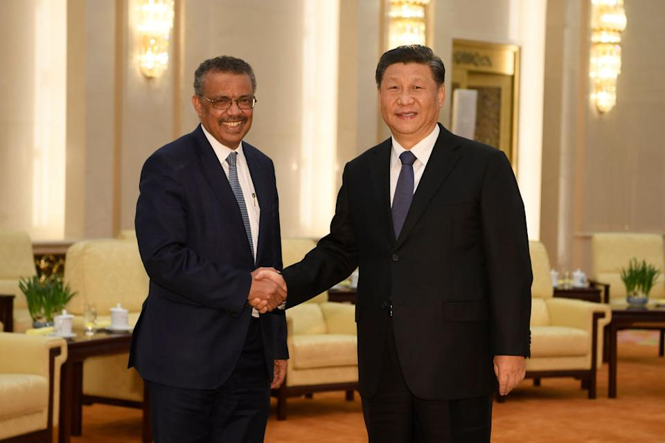 Tedros Adhanom, director general of the World Health Organization, shakes hands with Chinese President Xi Jinping in Beijing on January 28, 2020. Source: Getty
