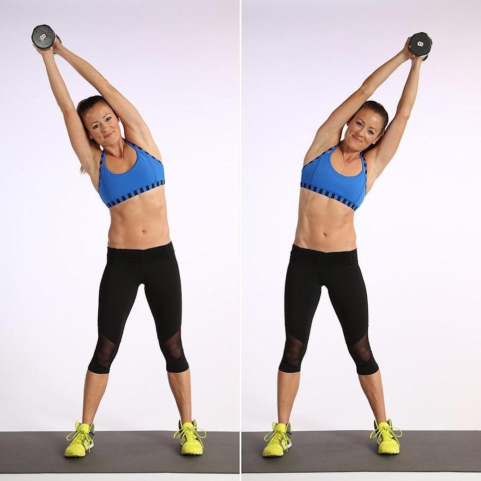 <p>The standing side bend works your obliques. We like that it simultaneously stretches one side of your torso while working the other.</p> <ul> <li>Stand with your feet a little wider than hip-width distance apart while holding a five- to 10-pound dumbbell over your head. Squeeze your head with your upper arms to fire up your core and protect your neck.</li> <li>Bend sideways to the right, squeezing your waist on the right side. Keep your neck as neutral as possible, looking forward, not down.</li> <li>Pull the left ribs down to return to standing upright. This focuses the work on the left obliques. Switch sides, and bend to the left to complete one rep.</li> </ul>