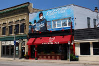 A mural is displayed above a Milwaukee bar on July 5, 2020, depicting Milwaukee Bucks players activism following the police shooting of Jacob Blake in Kenosha, Wis. The Bucks are about to host an NBA Finals game for the first time since 1974 as they chase the league title that has eluded them for half a century. Much has changed since they last got this close to a championship. (AP Photo/Carrie Antlfinger)