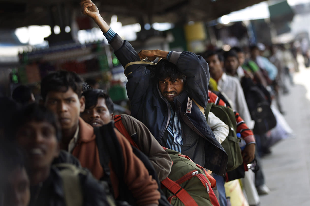 Indians crowd a platform to board a train in New Delhi, India.