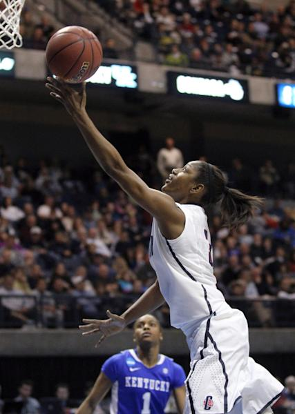 Connecticut guard Tiffany Hayes scores a basket during the second half of an NCAA women's college basketball tournament regional final against Kentucky in Kingston, R.I., Tuesday, March 27, 2012. Connecticut defeated Kentucky 80-65. (AP Photo/Stew Milne)