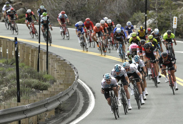 The peloton races down Highway 88 after crossing Carson Pass in the Central Sierra Nevada during the sixth stage of the Tour of California cycling race near Kirkwood, Calif., Friday, May 18, 2018. (AP Photo/Rich Pedroncelli)