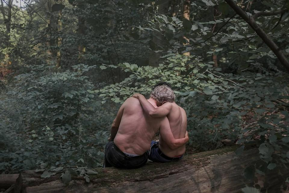 <p>Jochen (71) and Mohamed (21; not his real name) sit in the Tiergarten, Berlin. Jochen fell in love after meeting Mohamed, then a sex worker in the park. They have been dating for 19 months. (Heba Khamis) </p>