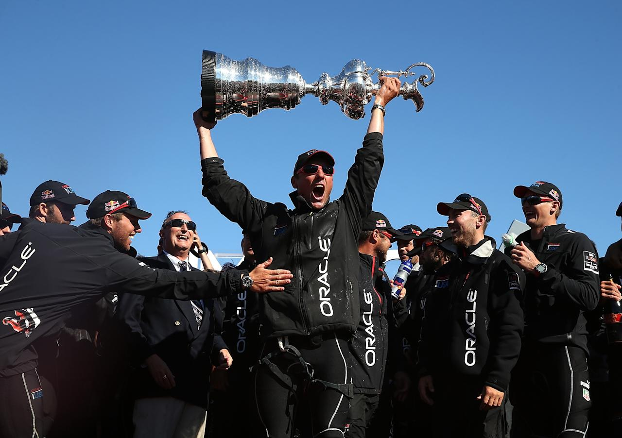 SAN FRANCISCO, CA - SEPTEMBER 25: Oracle Team USA skippered by James Spithill celebrates onstage after defending the Cup as they beat Emirates Team New Zealand to defend the America's Cup during the final race on September 25, 2013 in San Francisco, California. (Photo by Justin Sullivan/Getty Images)