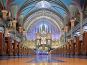 """Built in the 1820s in Old Montreal, <a href=""""https://www.cntraveler.com/activities/montreal/notre-dame-basilica-of-montreal?mbid=synd_yahoo_rss"""" rel=""""nofollow noopener"""" target=""""_blank"""" data-ylk=""""slk:Notre-Dame Basilica"""" class=""""link rapid-noclick-resp"""">Notre-Dame Basilica</a> is a stunning example of the Gothic Revival style, featuring two soaring towers, hundreds of intricate wooden carvings, and a looming Casavant Frères pipe organ that dates back to 1891. Be sure not to miss Moment Factory's astounding Aura, a ticketed 45-minute multimedia spectacle that combines lights, orchestral music, and the grandiose architecture in a unique three-act experience."""
