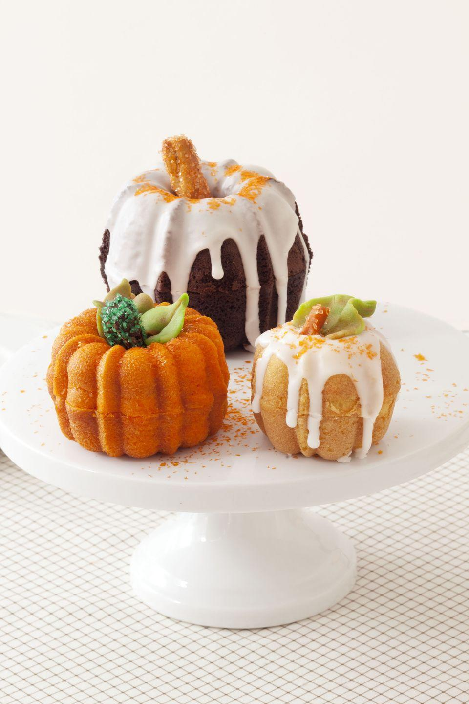 """<p>Snack on these sweet, miniature cakes while you wait for<em> <a href=""""https://www.amazon.com/Its-Great-Pumpkin-Charlie-Brown/dp/B015X7GM7E/?tag=syn-yahoo-20&ascsubtag=%5Bartid%7C10055.g.2700%5Bsrc%7Cyahoo-us"""" rel=""""nofollow noopener"""" target=""""_blank"""" data-ylk=""""slk:It's the Great Pumpkin, Charlie Brown"""" class=""""link rapid-noclick-resp"""">It's the Great Pumpkin, Charlie Brown</a></em> to start playing on TV. </p><p><a class=""""link rapid-noclick-resp"""" href=""""https://www.amazon.com/Nordic-Ware-Collection-Anniversary-Bundtlette/dp/B004RB4SII/?tag=syn-yahoo-20&ascsubtag=%5Bartid%7C10055.g.2700%5Bsrc%7Cyahoo-us"""" rel=""""nofollow noopener"""" target=""""_blank"""" data-ylk=""""slk:SHOP PUMPKIN CAKE MOLDS"""">SHOP PUMPKIN CAKE MOLDS</a></p><p><em><a href=""""https://www.goodhousekeeping.com/food-recipes/a15461/pumpkin-patch-cakes-recipe-ghk1013/"""" rel=""""nofollow noopener"""" target=""""_blank"""" data-ylk=""""slk:Get the recipe for Pumpkin Patch Cakes »"""" class=""""link rapid-noclick-resp"""">Get the recipe for Pumpkin Patch Cakes »</a></em></p>"""