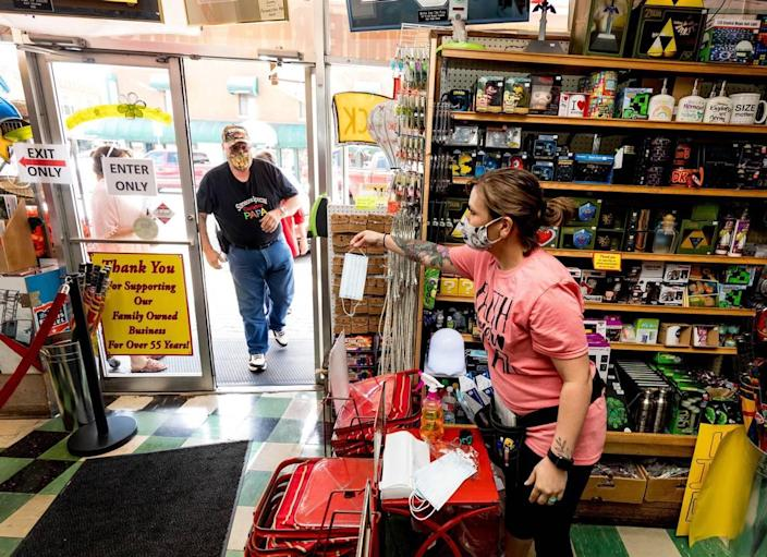 Marci Boone hands out masks to each customer wanting one at Dick's 5 & 10. Branson leaders debated a proposed mask mandate for more than 8 hours Thursday.