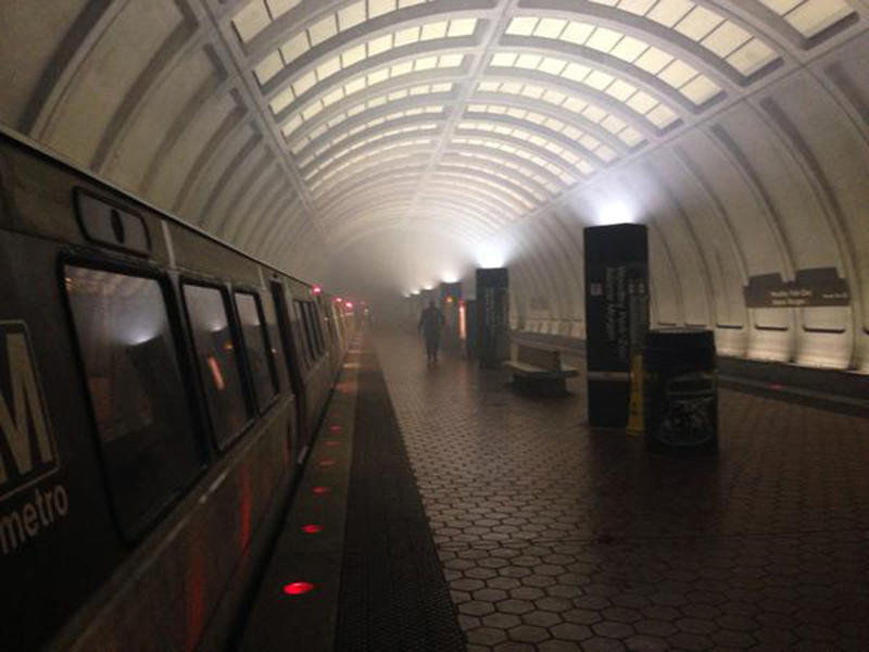 The Woodley Park Metro station in Washington, DC is shown filling with smoke in this handout photo taken February 21, 2015, provided by Liz Palka. Riders on a Washington subway train were forced to evacuate after faulty brakes caused smoke to fill a station stop in the nation's capital on Saturday, officials said. The incident comes just one month after an arcing insulator in a tunnel near the L'Enfant Plaza station filled with smoke, killing one woman and sending 84 people to area hospitals.  REUTERS/Liz Palka/Handout  (UNITED STATES - Tags: DISASTER TRANSPORT TPX IMAGES OF THE DAY) ATTENTION EDITORS - THIS PICTURE WAS PROVIDED BY A THIRD PARTY. REUTERS IS UNABLE TO INDEPENDENTLY VERIFY THE AUTHENTICITY, CONTENT, LOCATION OR DATE OF THIS IMAGE. FOR EDITORIAL USE ONLY. NOT FOR SALE FOR MARKETING OR ADVERTISING CAMPAIGNS. NO SALES. NO ARCHIVES. THIS PICTURE IS DISTRIBUTED EXACTLY AS RECEIVED BY REUTERS, AS A SERVICE TO CLIENTS