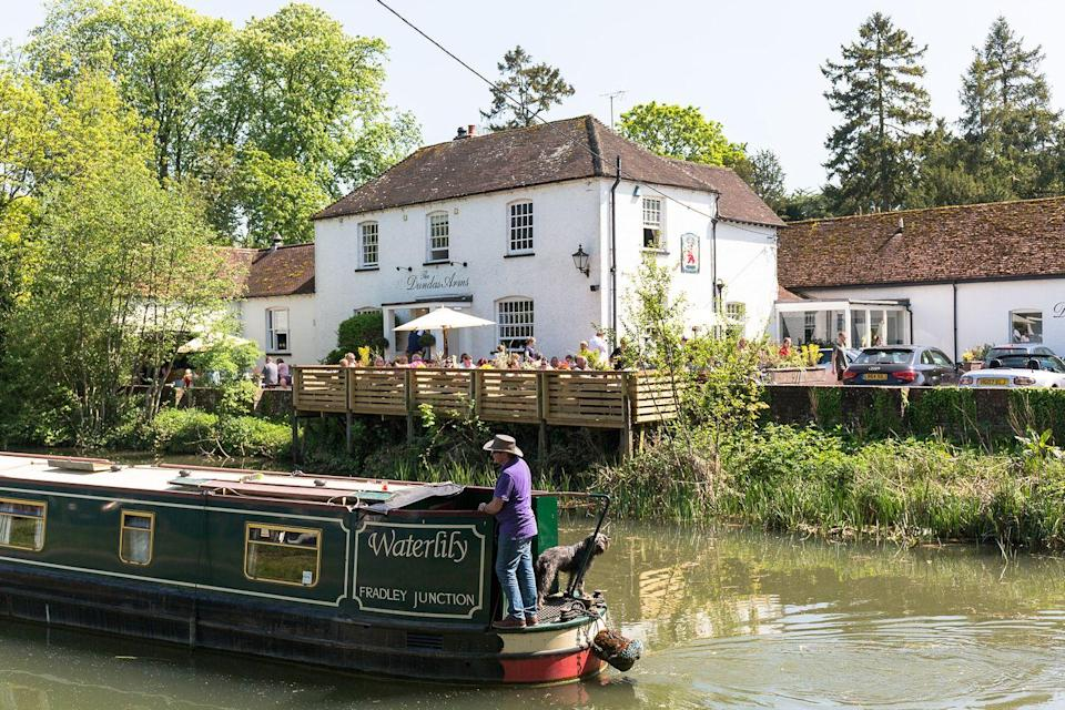 """<p>Perched in the charming town of Kintbury, this 18th century Grade II listed inn is an idyllic retreat for a weekend by the river. The <a href=""""https://www.redonline.co.uk/travel/inspiration/g503337/six-of-the-best-gastro-pubs-with-rooms/"""" rel=""""nofollow noopener"""" target=""""_blank"""" data-ylk=""""slk:pub with rooms"""" class=""""link rapid-noclick-resp"""">pub with rooms</a> has just eight rooms decorated in a gorgeous country house style. </p><p>Many of the bedrooms come with their own private terrace overlooking the canal, where you can sit back and enjoy breakfast the next morning or a sundowner in the early evening. Bliss! </p><p><a class=""""link rapid-noclick-resp"""" href=""""https://www.booking.com/hotel/gb/the-dundas-arms.en-gb.html?aid=2070929&label=weekend-trips-from-london"""" rel=""""nofollow noopener"""" target=""""_blank"""" data-ylk=""""slk:CHECK AVAILABILITY"""">CHECK AVAILABILITY</a> <br></p>"""