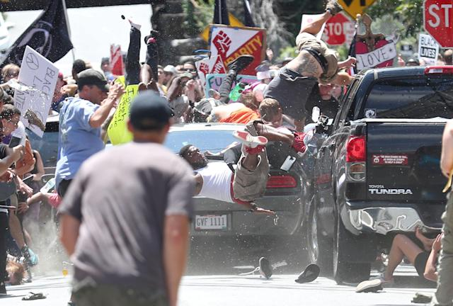 <p>Car attack: People are thrown into the air as a car plows into a group of protesters demonstrating against a Unite the Right rally in Charlottesville, Va., Aug. 12, 2017.<br>The white nationalist rally, opposing city plans to remove a statue of Confederate icon General Robert E. Lee, attracted counter-protests. James Alex Fields Jr drove his car at high speed into a sedan, propelling it and a minivan into a group of anti-racist protesters, killing Heather Heyer (32) and injuring a further 19 people. Fields fled the scene in his own vehicle, but was stopped by Charlottesville police and later charged with murder. (Photo: Ryan M. Kelly/The Daily Progress) </p>