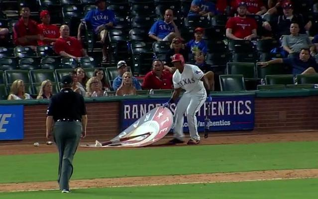 Adrian Beltre moves the on-deck circle while umpire Gerry Davis looks on. (MLB)