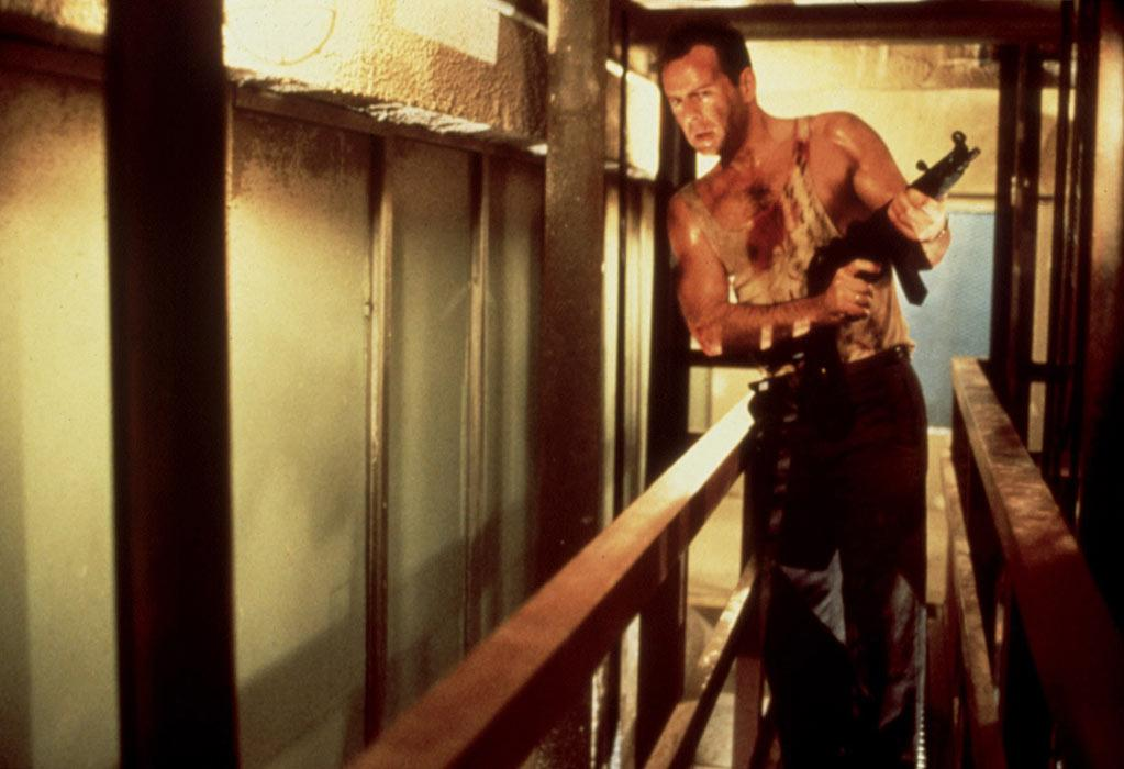 """<a href=""""http://movies.yahoo.com/movie/1800057265/info"""">Die Hard</a>: Just a big, booming action flick, an unapologetic blockbuster, and very much a product of its time. Bruce Willis is front and center, at the height of his '80s-era popularity, in one of the main roles that would define his varied career. As New York cop John McClane, he's quick-witted and ready for anything -- and he delivers a line that would become his signature. (Sorry, we can't repeat it here. We are a family-friendly news service.) Still, director John McTiernan's film remains funny, tense and gripping, with Willis and an excellent Alan Rickman going toe-to-toe during a hostage crisis in an L.A. skyscraper."""