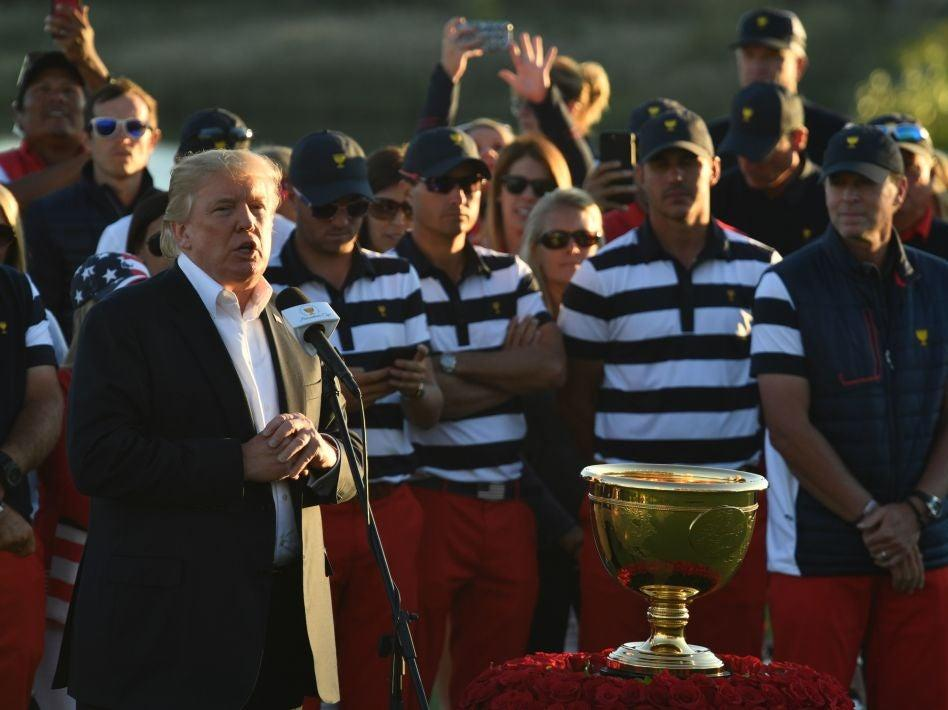 <p>Donald Trump speaks during the trophy presentation of the Presidents Cup in 2017</p> (AFP via Getty Images)