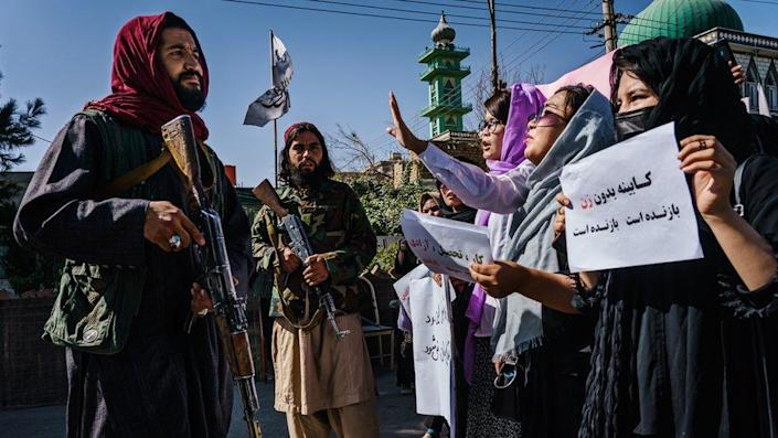 Taliban fighters approach female protestors in Kabul