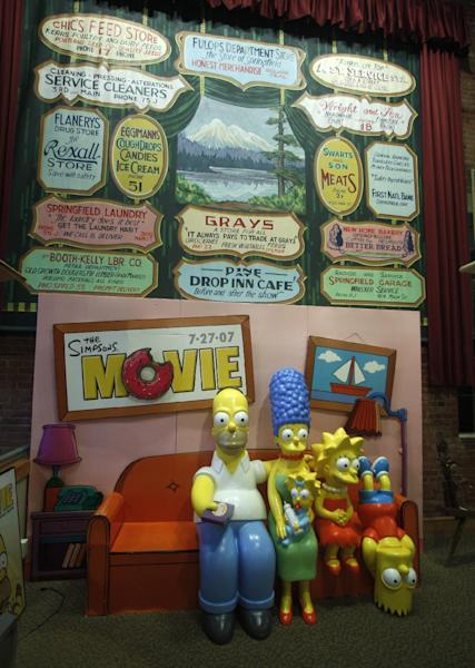 """The Simpsons Couch is shown on display at the Springfield Museum Tuesday, April 10, 2012, in Springfield, Ore. One of the best-kept secrets in television history has been revealed, with """"The Simpsons"""" creator Matt Groening pointing to Springfield, Ore., as the inspiration for the animated hometown of Homer and his dysfunctional family. Groening told Smithsonian magazine, published online Tuesday, that he was inspired by the television show """"Father Knows Best,"""" which took place in a place called Springfield. Springfield, Ore., is 100 miles south of Groening's hometown of Portland. (AP Photo/Rick Bowmer)"""