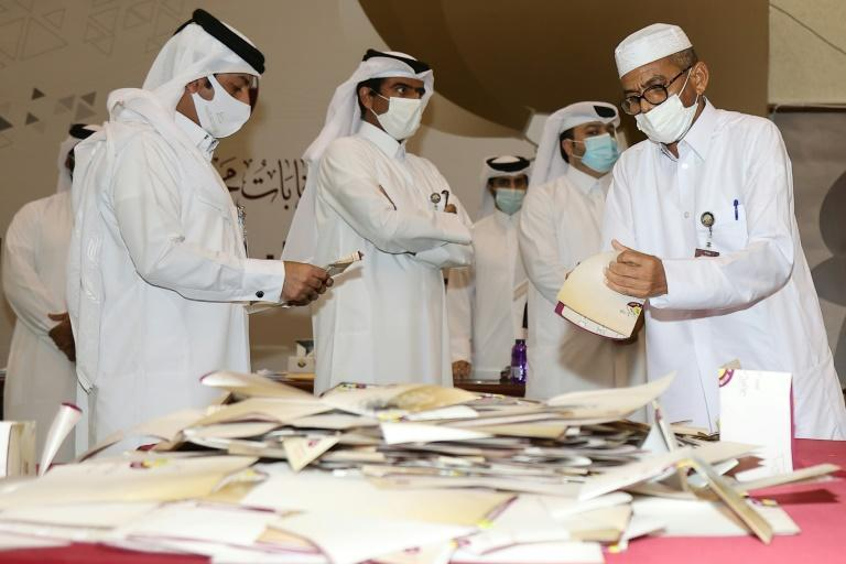 Qatari election officials count ballots at a polling station in the capital Doha, on October 2, 2021 after voting ended in the country's first ever legislative election (AFP/KARIM JAAFAR)