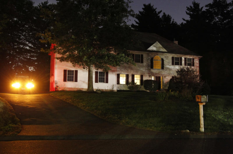 A police car sits in the driveway of the home of 26-year-old Rezwan Ferdaus, in Ashland, Mass., Wednesday, Sept. 28, 2011. Ferdaus has been arrested and accused of plotting to destroy the Pentagon and the U.S. Capitol with large remote-controlled aircraft filled with explosives.  (AP Photo/Steven Senne)