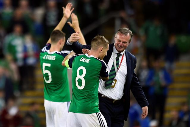 Soccer Football - 2018 World Cup Qualifications - Europe - Northern Ireland vs Czech Republic - Belfast, Britain - September 4, 2017 Northern Ireland manager Michael O'Neill and Steven Davis celebrate after the match REUTERS/Clodagh Kilcoyne
