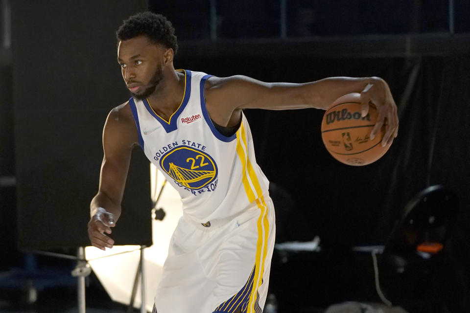 Golden State Warriors forward Andrew Wiggins poses for photos during the NBA basketball team's media day in San Francisco, Monday, Sept. 27, 2021. (AP Photo/Jeff Chiu)