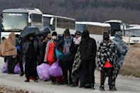 The mostly male migrants from Pakistan and Afghanistan are poorly equipped for Bosnia's freezing winter.