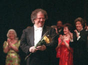 FILE - James Levine, center, the artistic director of the Metropolitan Opera, appears at a curtain call for the gala celebrating his 25th anniversary with the company in New York on April 28, 1996. Levine, who ruled over the Metropolitan Opera for 4 1/2 decades before being eased out when his health declined and then fired for sexual improprieties, died March 9, 2021 in Palm Springs, Calif., of natural causes, his physician of 17 years, Dr. Len Horovitz, said Wednesday, March 17. He was 77. (AP Photo/Osamu Honda, File)