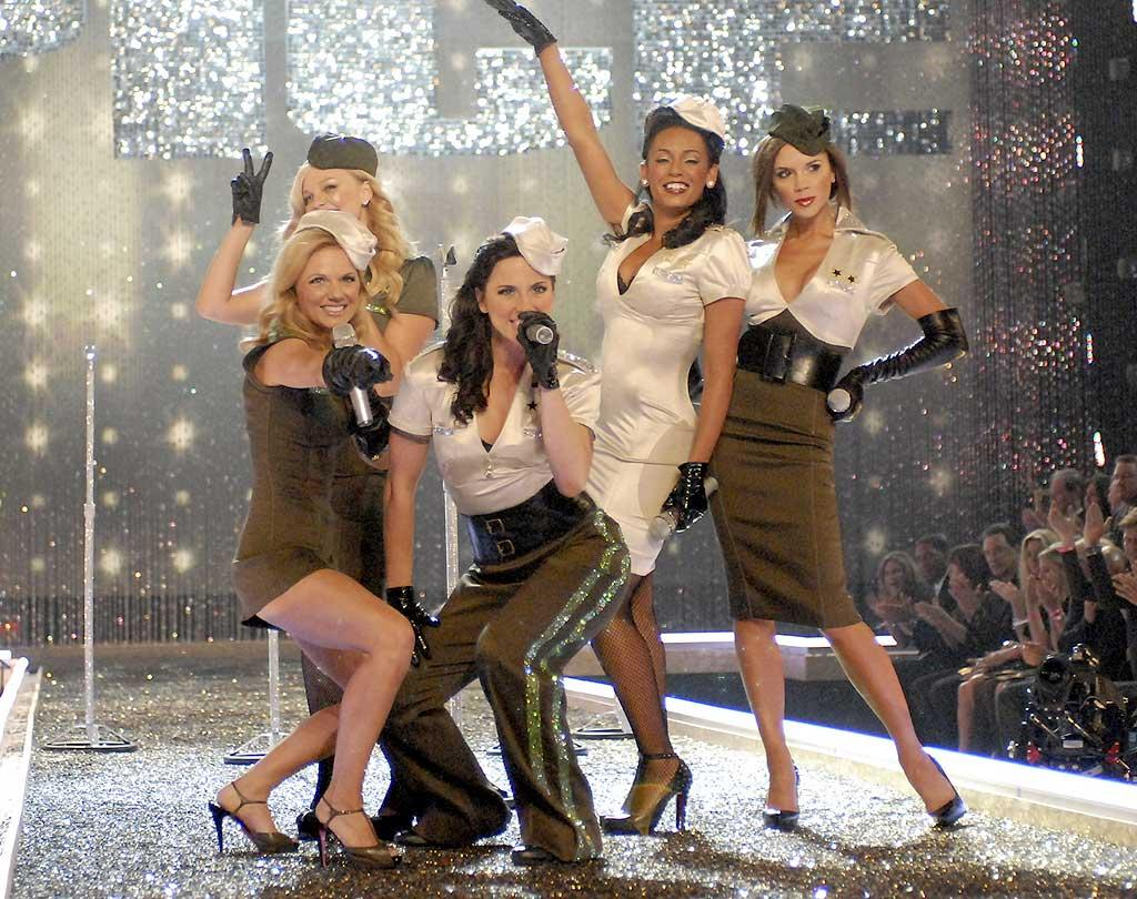 """The Spice Girls strike a pose in military themed outfits - with a sexy twist, of course. Kevin Mazur/<a href=""""http://www.wireimage.com"""" target=""""new"""">WireImage.com</a> - November 15, 2007"""