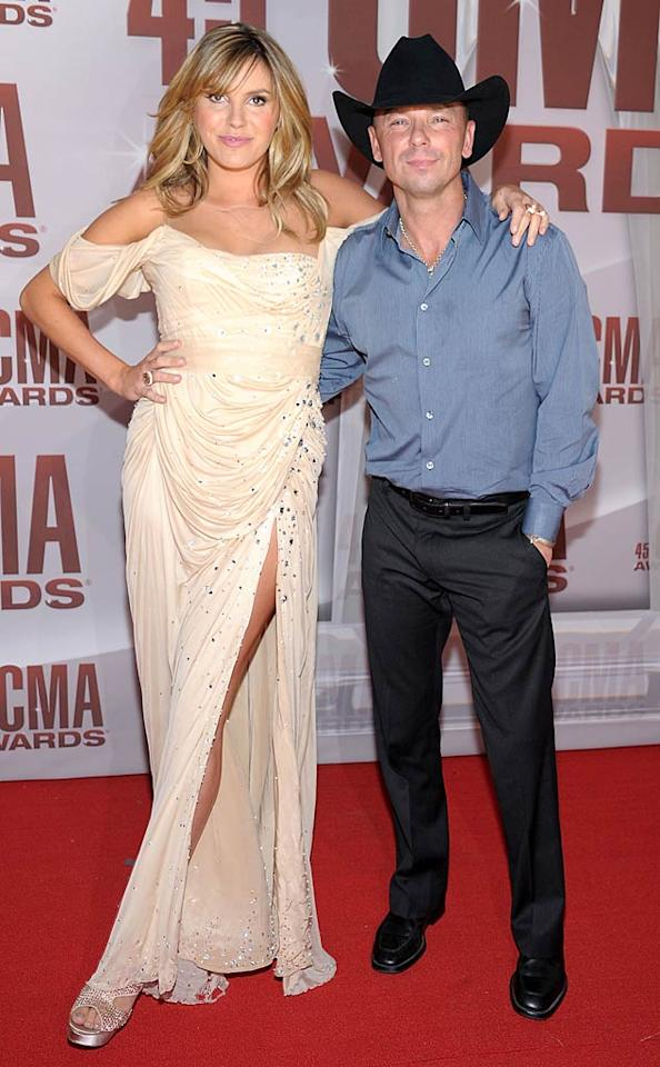 """Kenny Chesney and his """"You and Tequila"""" duet partner Grace Potter hit the arrivals line together. Kenny played it safe in a blue button-down and black slacks, while Grace dared to don a rather trashy gown for the ceremony. (11/9/2011)"""