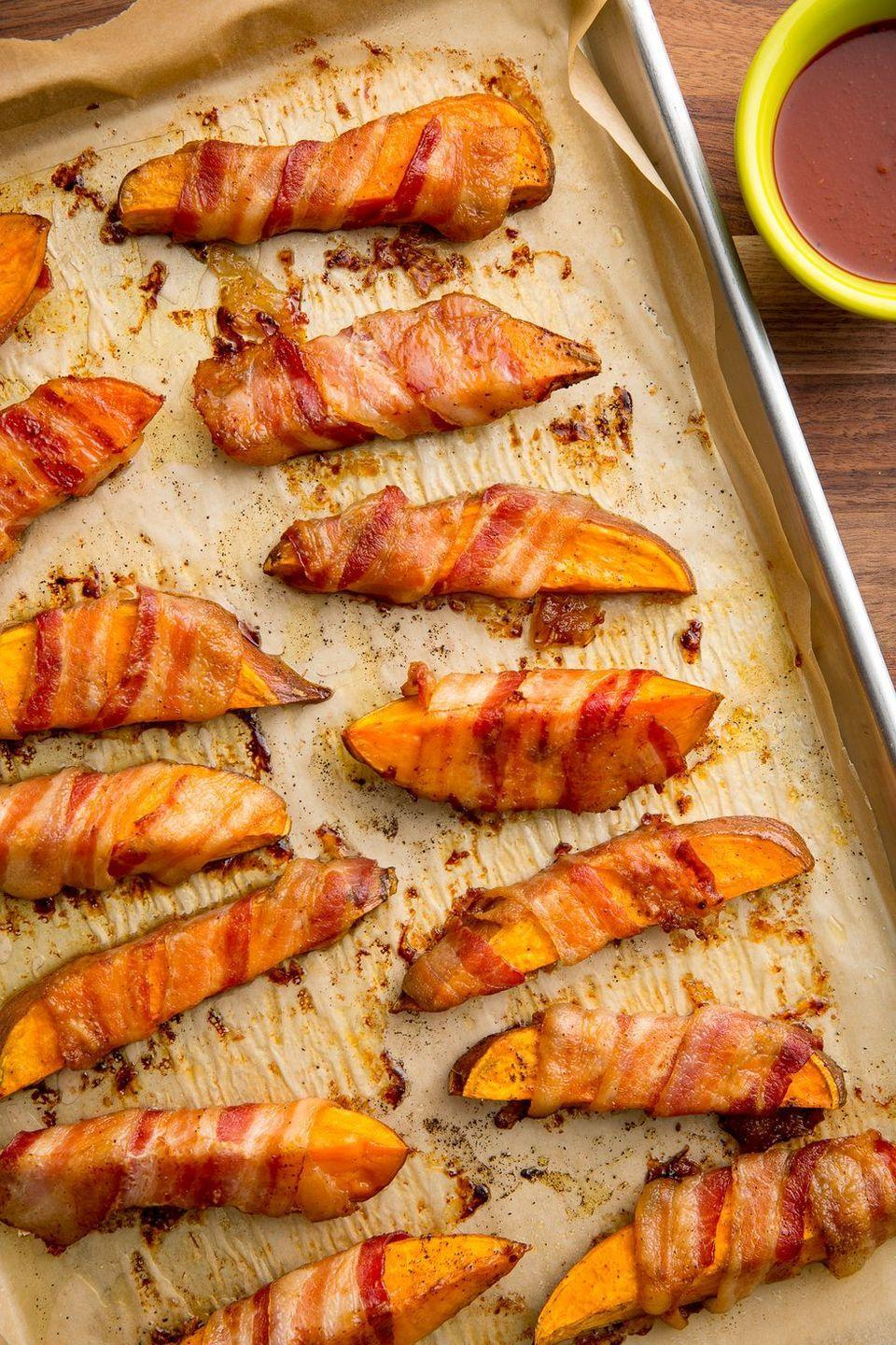 """<p>Regular fries, who? </p><p>Get the <a href=""""https://www.delish.com/uk/cooking/recipes/a35547816/bacon-wrapped-sweet-potato-fries-recipe/"""" rel=""""nofollow noopener"""" target=""""_blank"""" data-ylk=""""slk:Bacon-Wrapped Sweet Potato Fries"""" class=""""link rapid-noclick-resp"""">Bacon-Wrapped Sweet Potato Fries</a> recipe.</p>"""